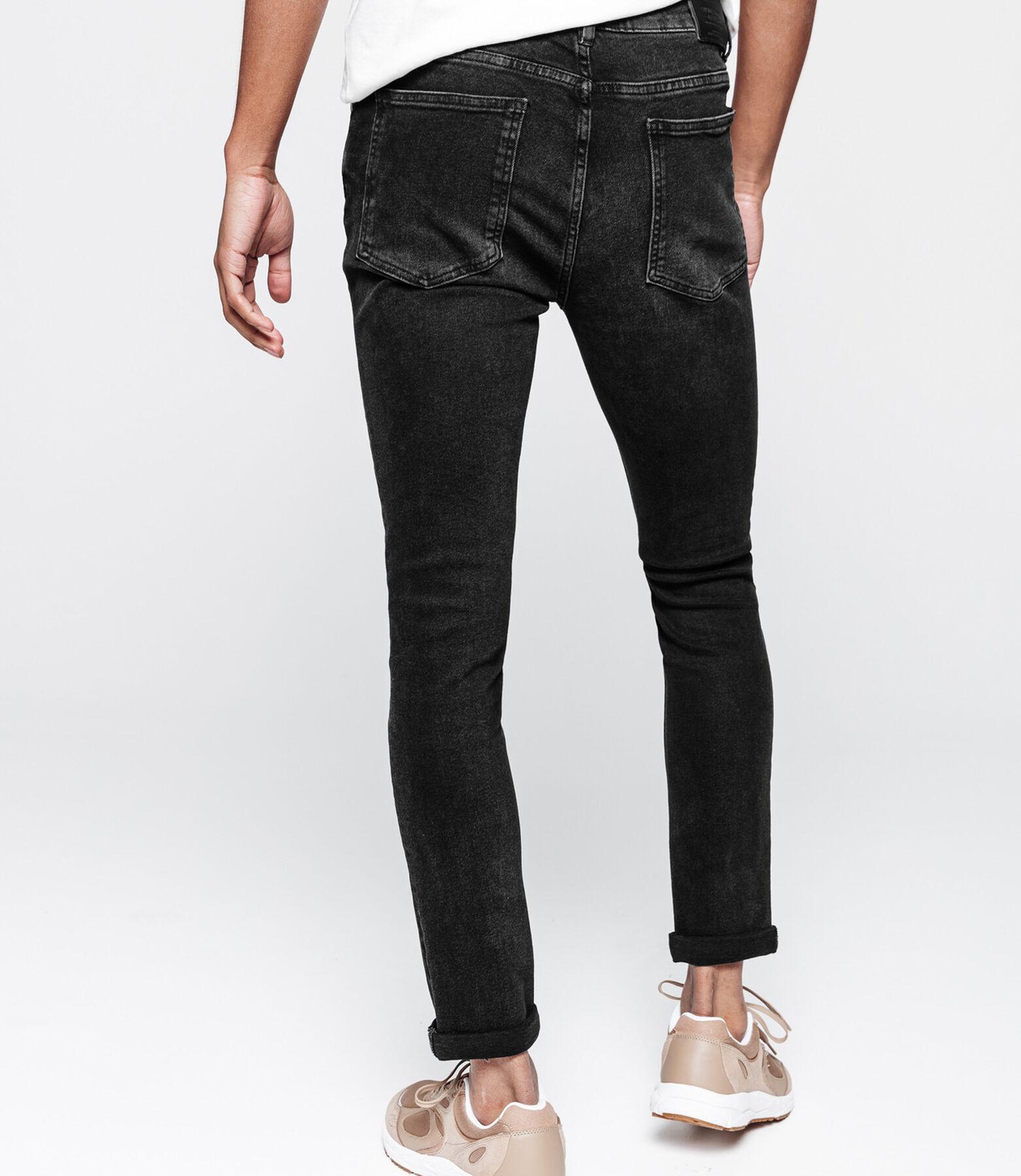 Jean slim noir en coton recyclé