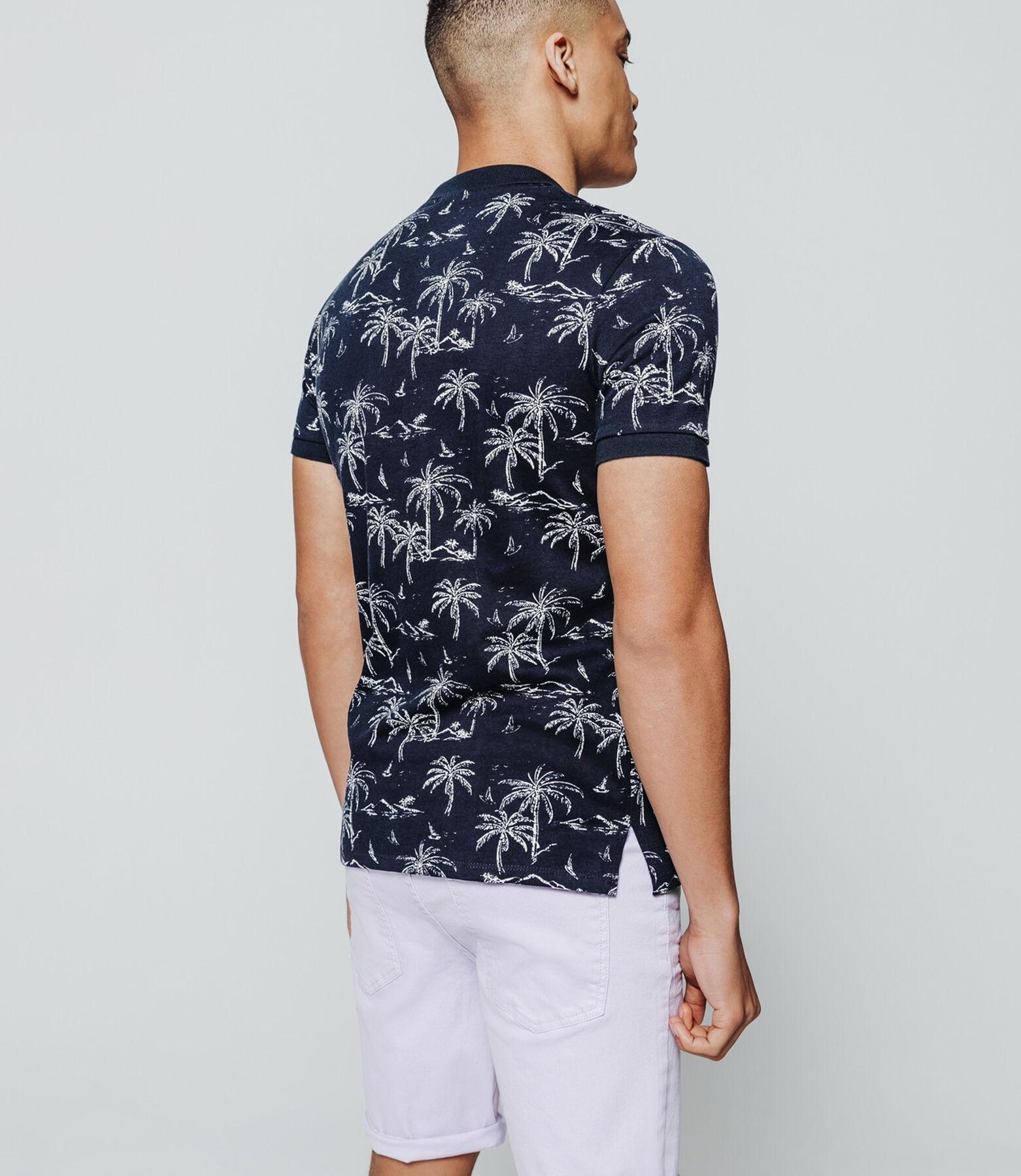 Polo imprimé palmiers