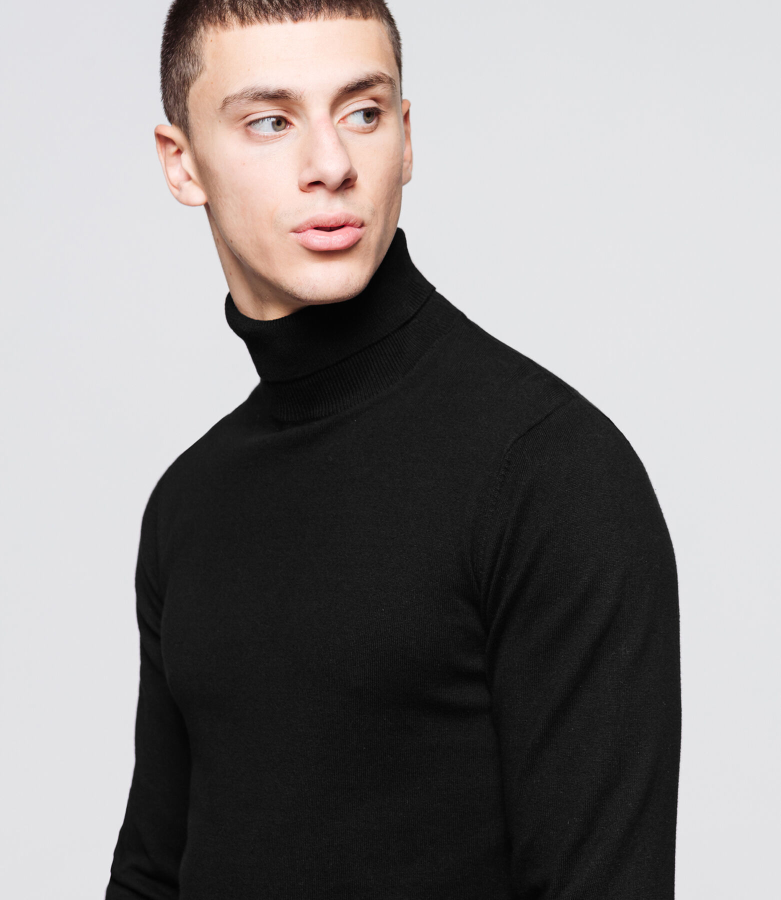 Pull col roulé