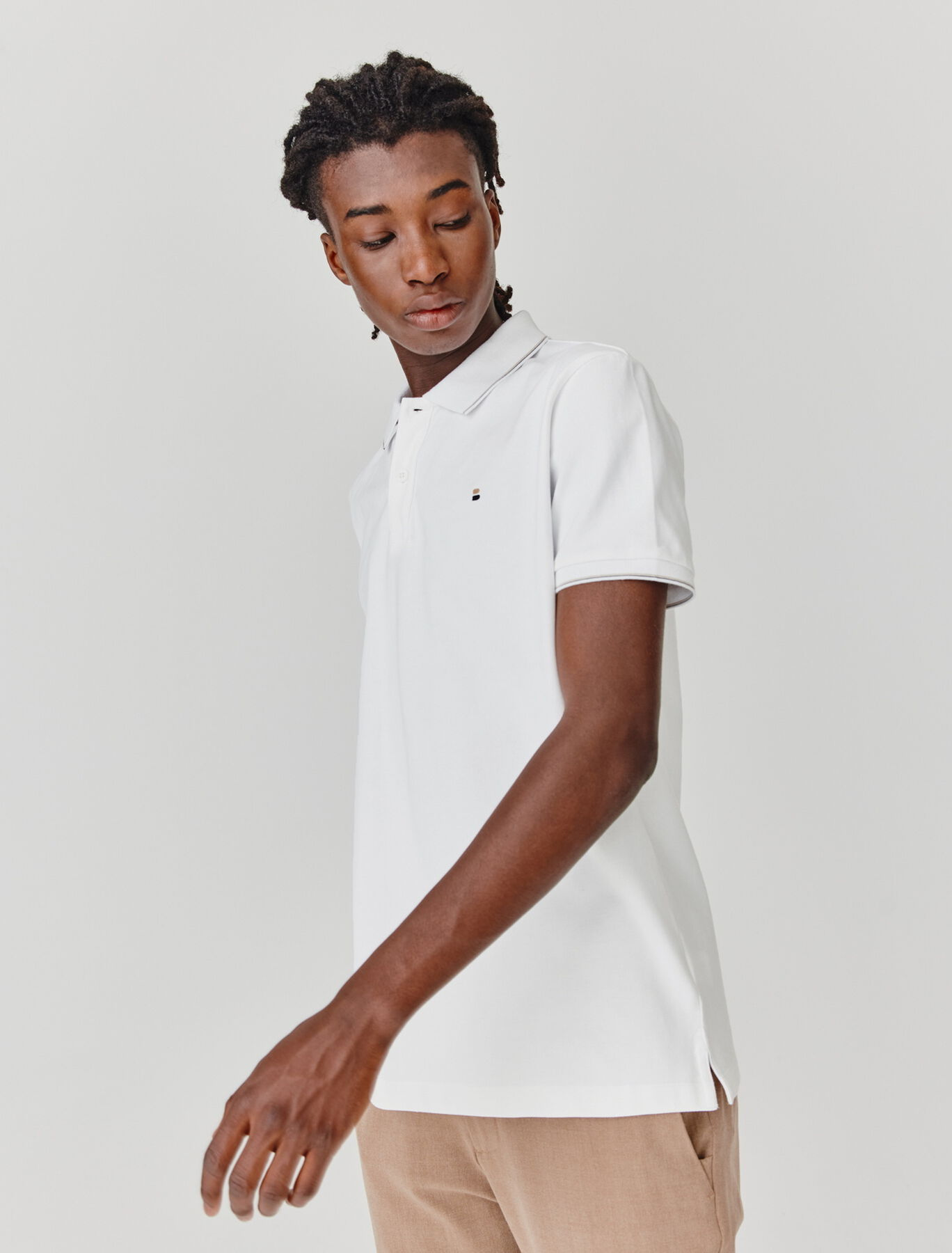 Polo finitions contrastantes