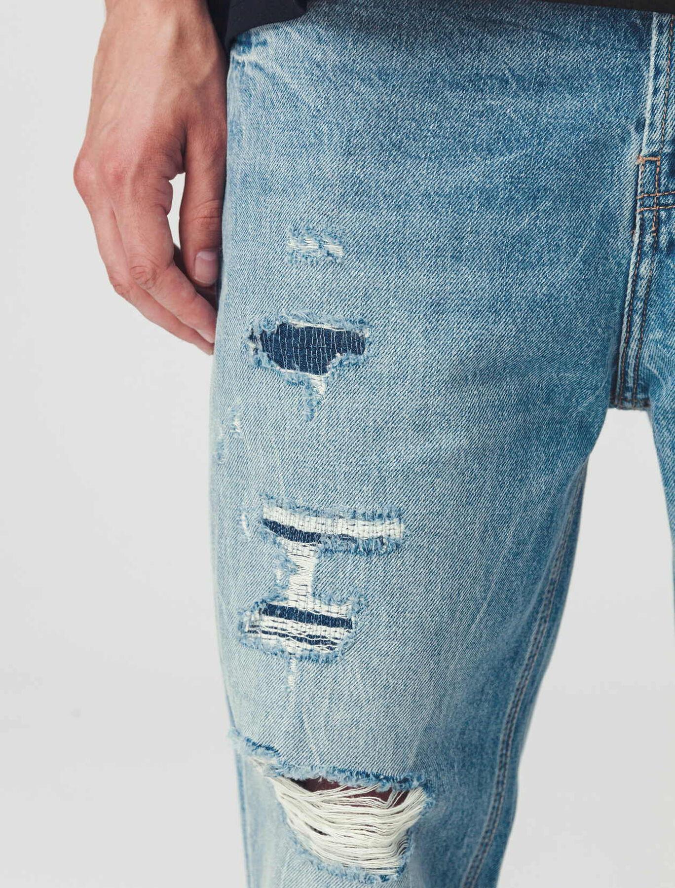 jean destroy avec empiècement patch