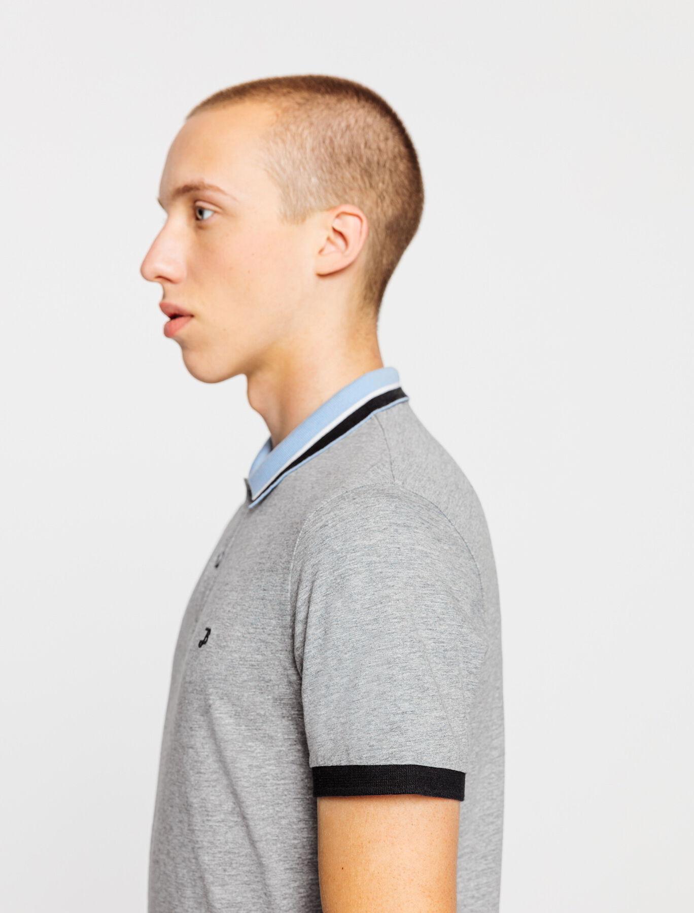 Polo chiné avec broderie poitrine